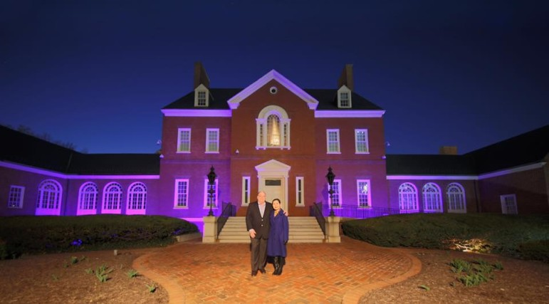 "Gov. Hogan and first lady Yumi Hogan he ""Light the Way"" initiative by lighting Government House blue in honor of Down Syndrome Awareness!"