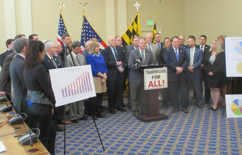 Howard County Executive  Allan Kittleman talks a press conference surrounded by Republican legislators opposing a proposed ranking system for transportation projects.