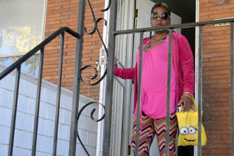 Sharlene Adams, on the porch of the rowhome she rents in West Baltimore, relies on the city's unpredictable public transportation network to get to health appointments.