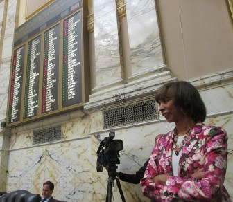 Sen. Catherine Pug catches paid sick leave vote on House floor.