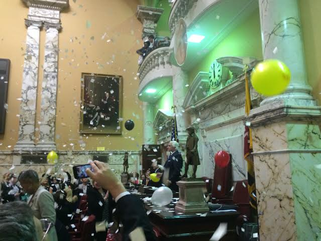 Paper and balloons come down on Senate President Mike Miller as the session closed at midnight.