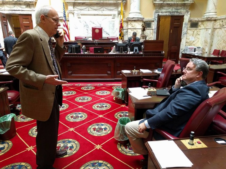 Sen. Paul Pinsky, left, and Sen. Richard Madaleno, floor leader of the College Affordability Act, discuss compromise on course-load requirement. From Sen. Bill Ferguson took the picture and