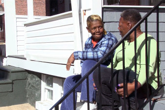 Darlene Parker, left, sits on her N. Bentalou Street steps talking with her neighbor, Sharlene Adams. Capital News Service photo by Nate Kresh.