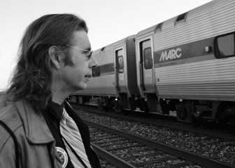 Gregory Sanders, long time public transit advocate and the vice president of the Purple Line Now coalition. Here, he stands in front of a MARC train at the College Park Metro station, which he takes every day from his home in Ellicott City. His father, Harry Sanders, first proposed the Purple Line.
