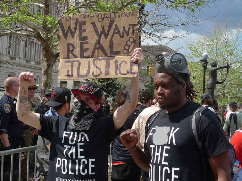 Demonstrators last May at Baltimore City hall. Photo by Susan Melkisethian with Flickr Creative Commons License
