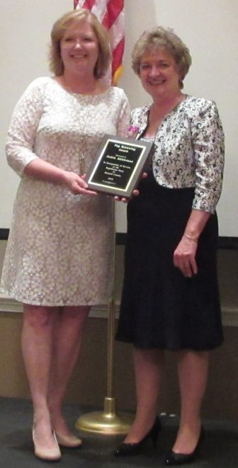 Robin KIttleman, wife ot the county executive, received Peg Browning Woman of the Year award from party chair Loretta Shields.