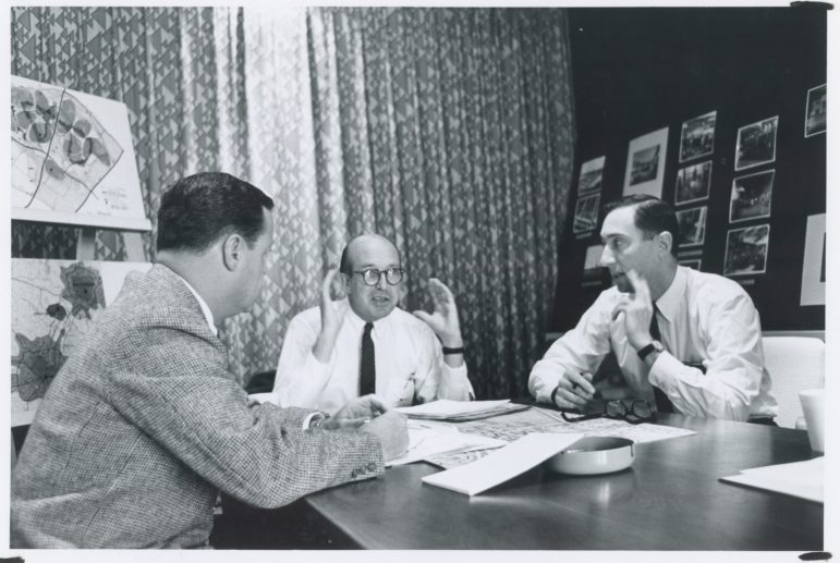 Jim Rouse, center, discusses plans for Columbia with lead designer Mort Hoppenfeld, right, and top manager Bill Finley. Photo by Robert de Gast, courtesy of Columbia Archives.