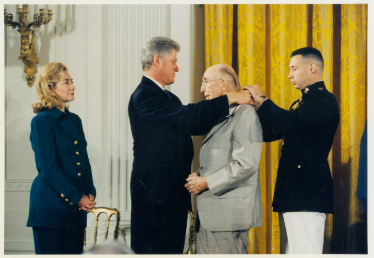 Jim Rouse is awarded the Medal of Freedom, the nation's highest civilian honor, by President Bill Clinton as Hillary Clinton looks on Sept. 28, 1995. Six months later Rouse died. White House photo, courtesy of Columbia Archives.