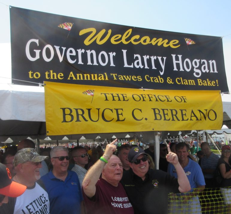 Lobbyist Bruce Bereano and Gov. Larry Hogan point to the welcome sign above the entrance to Bereano's circus-size tent. There were several welcome signs around Crisfield for the governor.