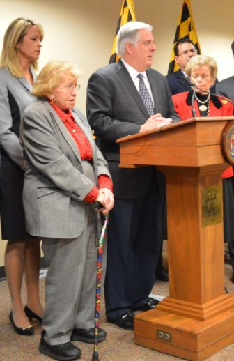 Helen Delich Bentley with cane stood next to Governor-elect Larry Hogan as he announced his transition team in November 2014.