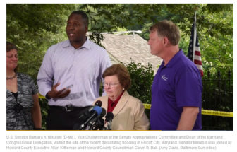 A screenshot from a Baltimore Sun video of Calvin Ball, Barbara Mikulski and Allan Kittleman in Ellicott City.