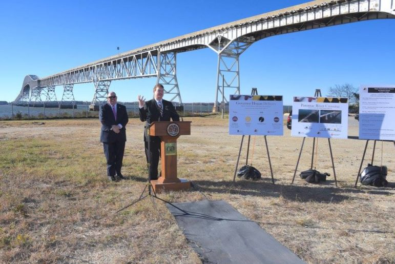 Transportation Secretary Pete Rahn and Gov. Larry Hogan anncounce plans to replace the Harry Nice Bridge behind them. Governor's Office Photo.
