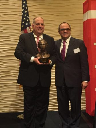 Gov. Larry Hogan receives the Charles Carroll of Carrollton award from Christopher Summers of the Maryland Public Policy Institute.