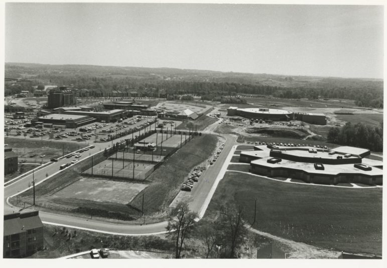 Wilde Lake Middle School, lower right, and Wilde Lake High School, upper right, were next to the village center. Morton Tadder photo. Courtesy of Columbia Archives