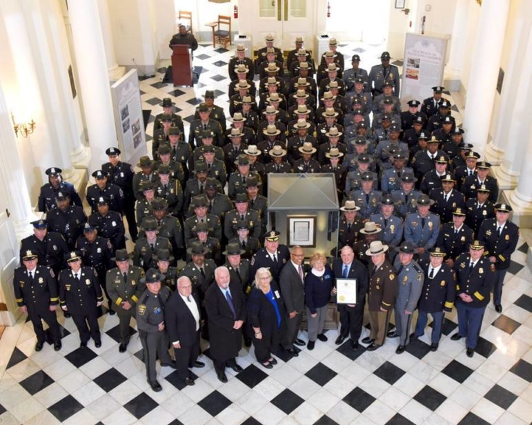 Gov. Larry Hogan stands with police in the rotunda of the State House, holding the proclamation declaring Monday as Law Enforcement Appreciation Day. Governor's Office photo.