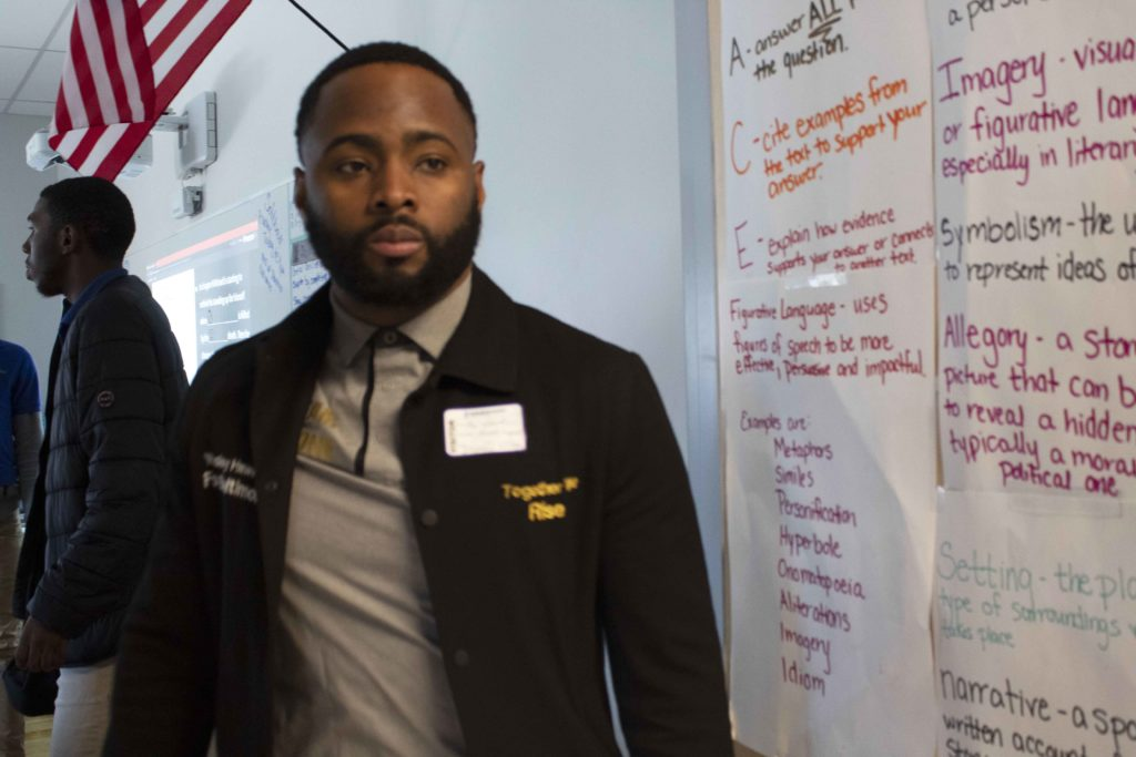 Wesley Hawkins, founder of The Nolita Project, walks into Reach! Partnership to check in with students he mentors in spring 2020. (Photo by Victoria Daniels/Capital News Service)